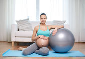 Happy pregnant woman with fitball at home — Stock Photo
