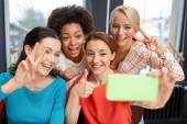 Happy young women taking selfie with smartphone — Stok fotoğraf