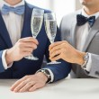Close up of male gay couple with champagne glasses — Stock Photo #69598257