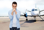 Man thinking over airplane on runway background — Stock Photo