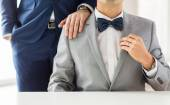 Close up of male gay couple with wedding rings on — Stok fotoğraf