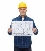 Smiling male builder in helmet with blueprint — Stok fotoğraf