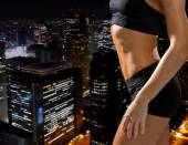 Close up of athletic female abs in sportswear — Stock Photo