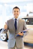 Happy man at auto show or car salon — Foto de Stock