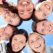 Smiling friends in circle on summer beach — Stock Photo #69826465