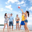 Group of happy friends playing beach ball — Stock Photo #69826555