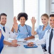 Group of happy doctors meeting at hospital office — Stock Photo #69827415