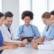 Group of happy doctors meeting at hospital office — Stock Photo #69827429