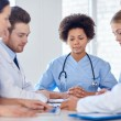 Group of happy doctors meeting at hospital office — Stock Photo #69827439