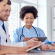 Group of happy doctors meeting at hospital office — Stock Photo #69827487