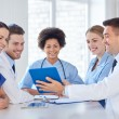 Group of happy doctors meeting at hospital office — Stock Photo #69827527