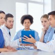 Group of happy doctors meeting at hospital office — Stock Photo #69827539