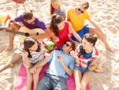 Group of happy friends having fun on beach — Stock Photo