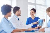 Group of happy doctors meeting at hospital office — Stock Photo