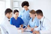 Group of doctors with tablet pc at hospital — Stock Photo