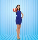 Happy young woman in blue dress with present — Stock Photo