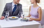 Close up of couple talking at restaurant — Stock Photo