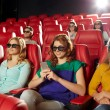 Happy woman with smartphone in 3d movie theater — Stock Photo #70200451