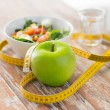 Close up of green apple and measuring tape — Stock Photo #70201019