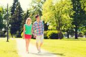 Smiling couple walking in park — Stock Photo
