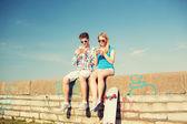 Smiling couple having fun outdoors — Stock Photo