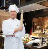Happy male chef cook holding rolling pin — Stock Photo