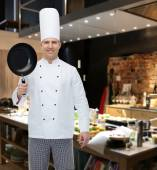 Happy male chef cook holding frying pan — Stock Photo
