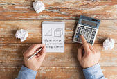 Close up of hands with calculator solving task — Stockfoto