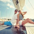 Smiling couple sitting on yacht deck — Stock Photo #70914277