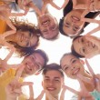 Group of smiling teenagers showing victory sign — Stock Photo #70917447