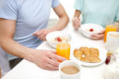 Close up of couple having breakfast at home — Stock Photo