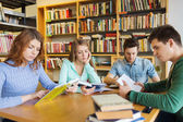 Students reading books in library — Stock Photo