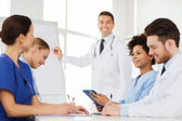 Group of doctors on presentation at hospital — Stock Photo
