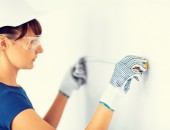 Architect measuring wall with flexible ruller — Stock Photo