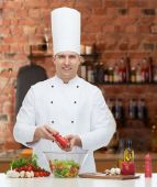 Happy male chef cook cooking food — Stock Photo