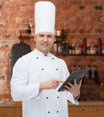 Happy male chef cook holding tablet pc — Stock Photo
