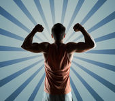 Young man or bodybuilder showing biceps — Stock Photo