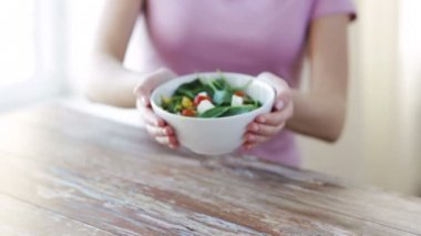 Close up of young woman hands showing salad bowl — Stock Video
