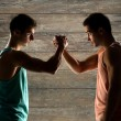 Two young men arm wrestling — Stock Photo #71194351