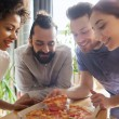 Happy business team eating pizza in office — Stock Photo #71196221