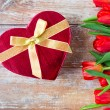 Close up of red tulips and chocolate box — Stock Photo #71417573