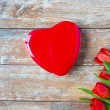 Close up of red tulips and chocolate box — Stock Photo #71417579