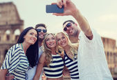Friends taking selfie with smartphone — Stock Photo