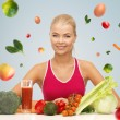 Happy woman with vegetarian food and vitamins — Stock Photo #71590445