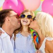 Family with colorful balloons — Stock Photo #71591573