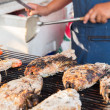Close up of cook hands grilling fish on street — Stock Photo #71593677