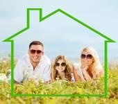 Happy family in sunglasses outdoors — Stock Photo