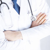 Doctor with stethoscope in white uniform — Stock Photo