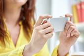 Close up of female hands with smartphone at home — Stock Photo