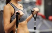 Close up of woman exercising on gym machine — Stock Photo